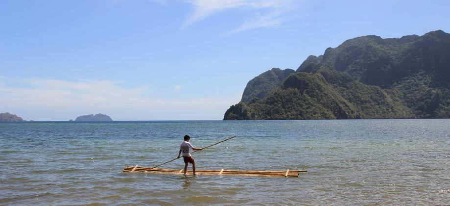 "Coron Island - kid on a ""boat"""